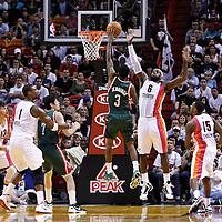 22 January 2012: Milwaukee Bucks point guard Brandon Jennings (3) goes for the floater over Miami Heat small forward LeBron James (6) during the Milwaukee Bucks 91-82 victory over the Miami Heat at the AmericanAirlines Arena, Miami, Florida, USA.