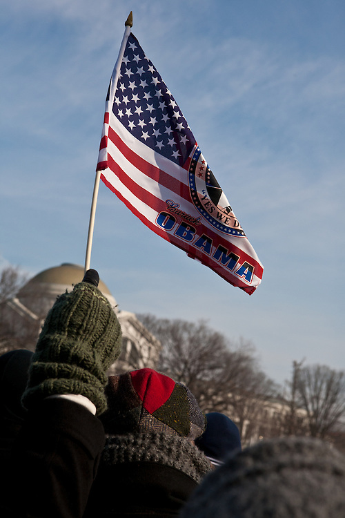 A cold attendee waves a flag at President Obama's inauguration.