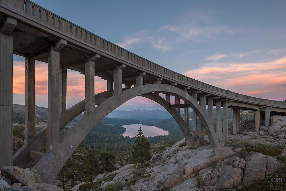 """""""Sunset at Rainbow Bridge 2"""" - Photograph taken at sunset of Rainbow Bridge on Old Highway 40 with Donner Lake and Truckee in the distance."""