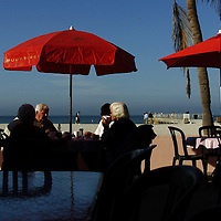 (02.03.2005)(PHOTO/CHIP LITHERLAND) -- Ohio seasonal residents Paul and Susie Stark of Huron, left to right, Barbara Stachowiak of Columbus, and Barbara and Paul Baldridge of Columbus chat at the Cafe on the Beach for the pancake and sausage breakfast at Manatee Public Beach in Holmes Beach on Anna Maria Island Thursday, February 3, 2005.