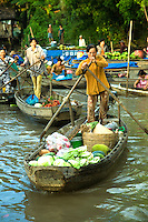 Boats loaded with produce from nearby orchards of the Mekong Delta converge to Phong Dien Floating Market every morning: fruits, coconuts, vegetables and fish are available here. Buyers are local traders  snapping up everything by the bushels to resell at local smaller markets or to wholesalers from big cities.  Large floating markets are not complete without  floating noodle shops, gas stations and coffee vendors. The best floating market in the Mekong Delta, Phong Dien has fewer motorised craft and more row boats. The market is at its best between 6 am and 8 am.