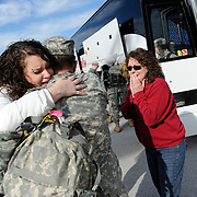 Rebkah Bumgardner, from left, of Lewisburg, Ky., hugs her brother Spec. Adam Richmond, with Bravo Company, 149th Brigade Support Battalion, Thursday, Dec. 8, 2011, as his mother Cynthia Richmond, also of Lewisburg, waits to hug him after he arrived at the National Guard Armory in Bowling Green, Ky. Family and friends welcomed home 75 Kentucky National Guard soldiers from a six month deployment in Iraq. The soldiers are from Bravo Company, 149th Brigade Support Battalion, which is part of the 149th Maneuver Enhancement Brigade. The brigade deployed more than 1,300 soldiers to Iraq in June in the Kentucky Guard's largest overseas deployment since World War II.(AP Photo/Daily News, Joe Imel)
