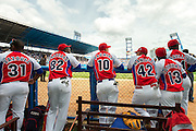 HAVANA, CUBA - MARCH 22, 2016: Yoandry Urgelles #14, Juan Carlos Torriente #13, Yordan Manduley #42, Yunior Paumier #10, William Saavedra #82, and Osvaldo Vazuez #31 of the Cuban National Team look on from the dugout before the start of the game against the Tampa Bay Rays at Estadio Latinoamericano on March 22, 2016 in Havana, Cuba. (Photo by Jean Fruth)