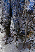 Close-up of tunnel worker in mud on the Big Dig in Boston