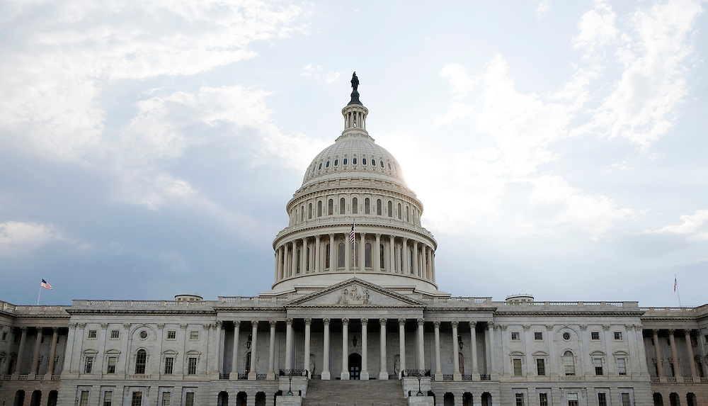 Clouds pass over Capitol Hill in Washington on August 1, 2011. Congressional leaders scrambled to line up Republican and Democratic votes for a White House House-backed deal to raise the borrowing limit and avert an unprecedented debt default.     REUTERS/Joshua Roberts    (UNITED STATES)