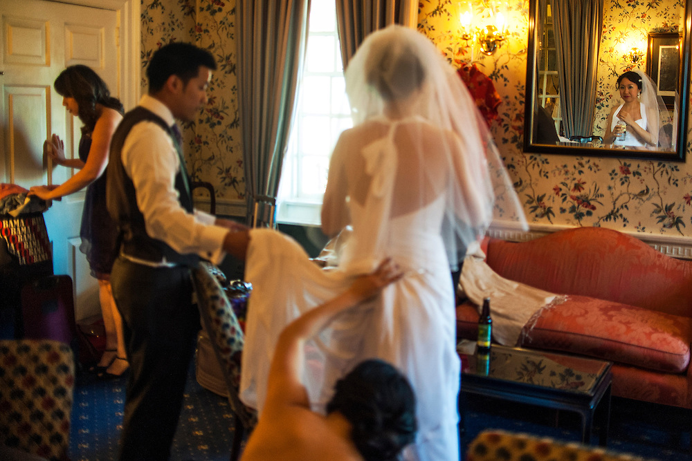 Photo by Matt Roth.Assignment ID: 30140754A..Evelyn Hsieh, foreground, is being bustled before she and her husband Michael Wong's introduction at the Mount Vernon Inn, in Mount Vernon, Virginia on Saturday, April 06, 2013.