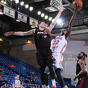 Delaware 87ers Guard Jamal Jones (22) drives towards the basket as Sioux Falls Skyforce Guard Tyler Johnson (10) defends in the first half of a NBA D-league regular season basketball game between the Delaware 87ers and the Sioux Falls Skyforce (Miami Heat) Tuesday, Jan. 27, 2015 at The Bob Carpenter Sports Convocation Center in Newark, DEL