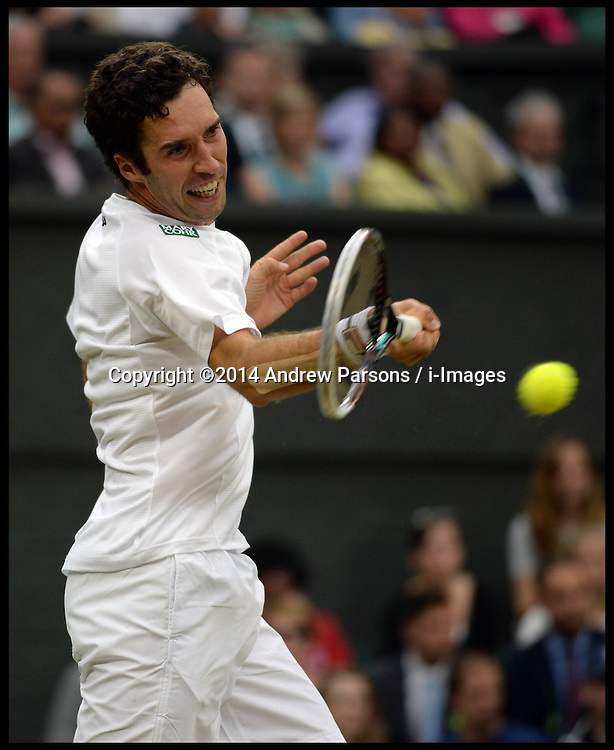Image ©Licensed to i-Images Picture Agency. 28/06/2014. London, United Kingdom. Mikhail Kukushkin playing Rafael Nadal on centre court on Day 6 of the Wimbledon Championship. Nadal went one to win the match. Picture by Andrew Parsons / i-Images