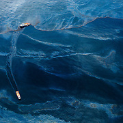 A ship leaves a path of oil-free water in its wake as it motors across the Gulf of Mexico, June, 2010.