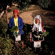 Akha women Milu (left - 55 years old) and Minee (right - 42 years old), near the rice-fields of the Akha village Huei Naam Kun that is located in the mountains near Chiang Rai.