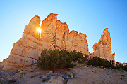 Sunlight shines through a gap in a rock formation at Plaza Blanca, near Abiquiu, New Mexico.