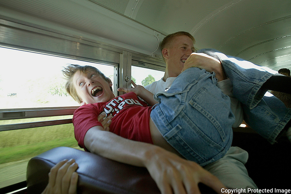 "Freshman David Vande Zandschulp gets his initiation to his first MOC-Floyd Valley band field trip as junior Matt Roesner playfully holds his head out the window of their bus which was enroute to Marshall, Mn.  At the competition that night, Vande Zandschulp admitted to being scared.  ""Once the music started, I felt in the groove,"" said the trumpet player."