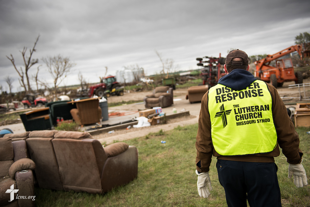 Newly elected South Dakota District President Rev. Scott Sailer of Sioux Falls surveys a destroyed farm on Monday, May 11, 2015, in Delmont, S.D. A tornado swept through the area the previous day and destroyed Zion Lutheran Church and nearby buildings. LCMS Communications/Erik M. Lunsford