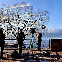 Geneva 2 Syria talks, taking place in Montreux, at the Montreux Palace Hotel. TV journalist preparing to go live, with Lake Geneva, and the Alps behind.