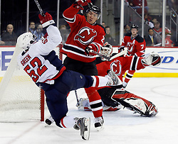 December 7, 2007; Newark, NJ, USA;  New Jersey Devils defenseman Karel Rachunek (28) hits Washington Capitals defenseman Mike Green (52) during the 3rd period at the Prudential Center in Newark, NJ.  The Devils won 3-2, their ninth win in a row.