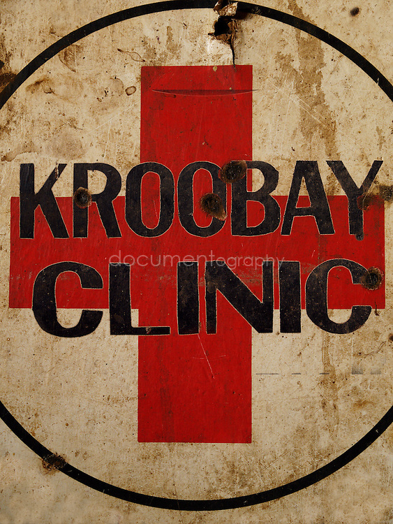Photo montage, Kroo Bay clinic sign, Kroo Bay, Freetown, Sierra Leone.