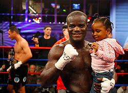 April 3, 2008; Brooklyn, NY, USA;  Joshua Clottey celebrates his stoppage win over Jose Luis Cruz-Felix at the Aviator Sports and Recreation Complex in Brooklyn, NY.