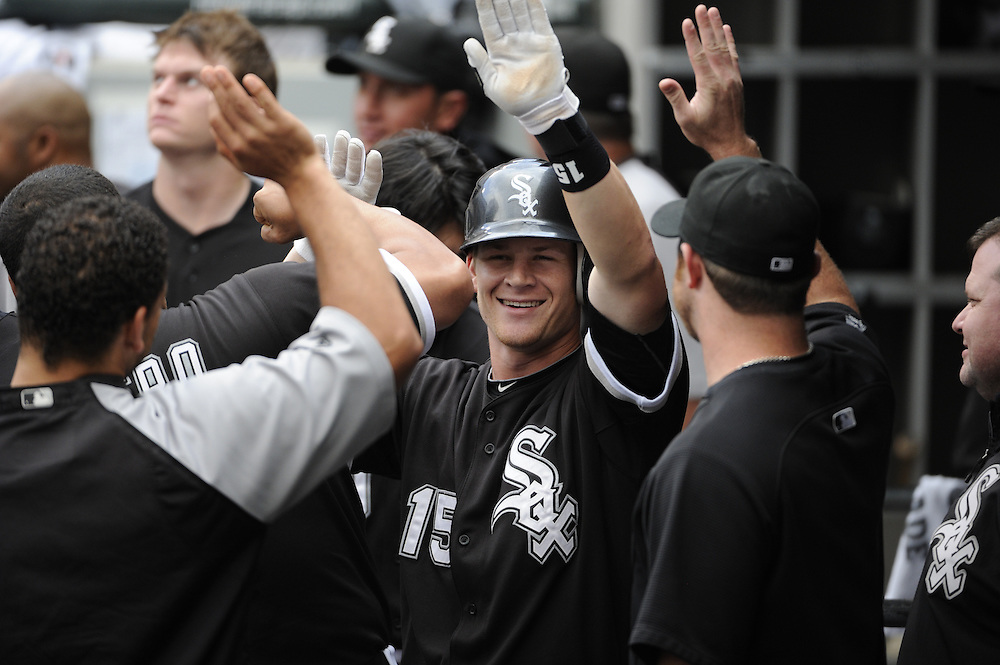 CHICAGO - JULY 10:  Gordon Beckham #15 of the Chicago White Sox celebrates with teammates in the dugout after hitting a home run in the fifth inning against the Kansas City Royals on July 10, 2010 at U.S. Cellular Field in Chicago, Illinois.  The White Sox defeated the Royals 5-1.  (Photo by Ron Vesely)
