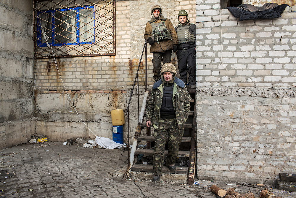 DEBALTSEVE, UKRAINE - FEBRUARY 8, 2015: Ukrainian soldiers outside a medical treatment point for Ukrainian fighters in Debaltseve, Ukraine. Fighting between pro-Russia rebels and Ukrainian forces there over the past two weeks has dealt steady casualties to Ukrainian fighters and civilians. CREDIT: Brendan Hoffman for The New York Times