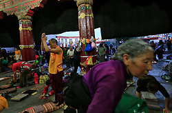 A picture made available on 19 September 2016 of Tibetan pilgrims praying outside the Jokhang Temple in the early morning in Lhasa, Tibet Autonomous Region, China, 09 September 2016. Jokhang Temple is considered one of the most sacred site for Tibetan buddhists built during the rule of King Songtsen Gampo in the 7th century.