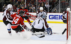 Feb 26, 2009; Newark, NJ, USA; New Jersey Devils right wing Brian Gionta (14) and Colorado Avalanche right wing Milan Hejduk (23) battle for the loose puck after a save by Colorado Avalanche goalie Andrew Raycroft (1) during the second period at the Prudential Center.