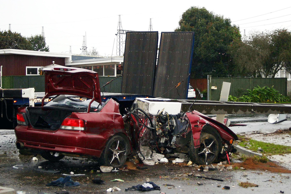 One person was killed and another taken to hospital after this car hit a lamp post on Massey Road, Mangere at 5.00am, Auckland, New Zealand, Sunday July 15, 2012. Credit:SNPA / Grahame Clark