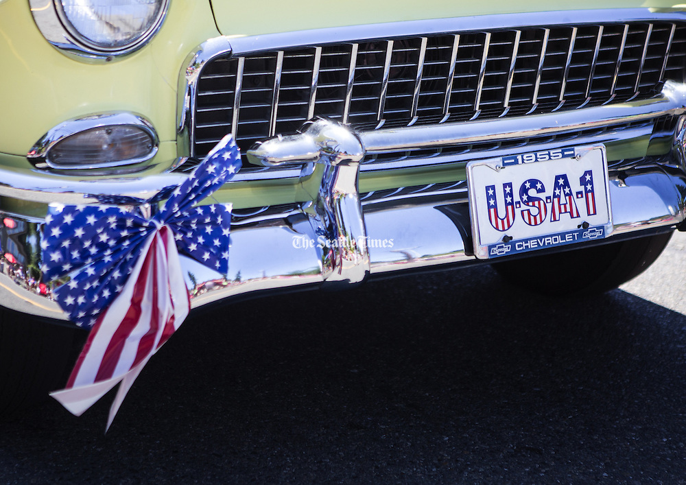 A 1955 Chevrolet rolls by with &quot;USA-1&quot; in the license plate holder during the annual Freedom Festival in Bothell on  July 4.<br />