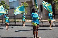 A flag team participates in a Labor Day parade and march near the security fence for the Democratic National Convention on Monday, September 3, 2012 in Charlotte, NC.