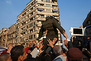 Egyptian protesters carry an effigy of Egyptian Army Field Marshall Hussein Tantawi through Tahrir Square during a million man march against military rule November 22, 2011 in central Cairo, Egypt. Thousands of protesters demanding the military cede power to a civilian government authority clashed with Egyptian security forces for a fourth straight day in Cairo, with hundreds injured and at least 29 protestors killed so far.  (Photo by Scott Nelson)