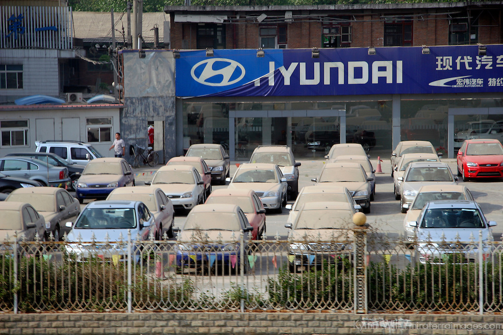 Asia, China, Beijing. Hyundai car dealer lot after a dust storm swept through Beijing, coating everything in dirt and dust.