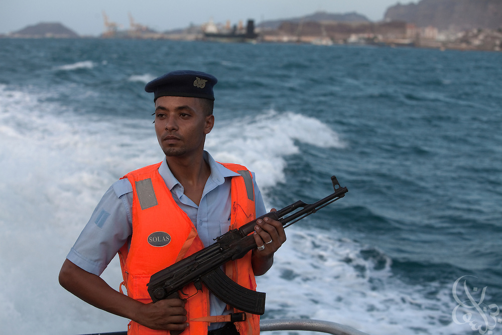 A Yemeni Coast Guard sailor stands watch on the deck of a small patrol boat during an April 13, 2010 patrol of the Aden port in Yemen. Yemen's Coast Guard was formed in 2003, and has approximately 1200 members and just over 50 patrol craft and ships in its arsenal. The nascent force is tasked with protecting the nearly 1200 miles of Yemen's territorial coastline against illegal smuggling (weapons and human traffic) and piracy and with securing the port of Aden, one of the largest natural ports in the world.