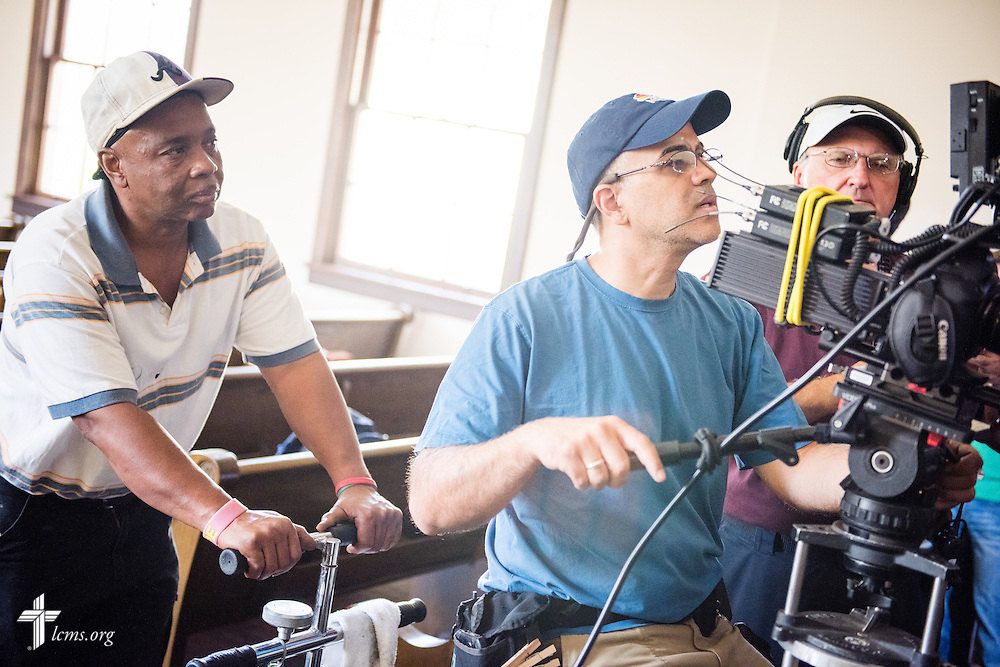 Volunteer Henry Jones (left) watches as Ben DeSousa, director of photography, records a scene on the campus of Concordia College Alabama during filming of 'The First Rosa' documentary on Thursday, September 25, 2014, in Selma, Ala. LCMS Communications/Erik M. Lunsford