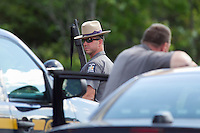 Federal, state and local law enforcement personnel swarm an area off of Route 30 near Lake Titus after cornering escaped murderers David Sweat and Richard Matt in Malone, New York on June 26, 2015.  At least one prisoner, Richard Matt, is believed to have been shot dead by law enforcement and second prisoner David Sweat may still on the loose.   Photo by Matthew Healey
