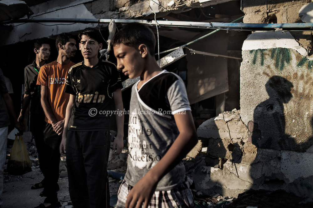 Gaza Strip, Jabalia refugee camp: Palestinians are seen in front a destroyed by shelling classroom in the UNRWA (United Nations Relief and Work Agency) Jabalia refugee camp school on July 30, 2014. ALESSIO ROMENZI