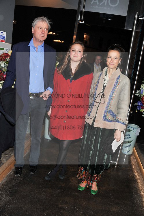Left to right, The MARQUESS OF WORCESTER, his daughter LADY BELLA SOMERSET and the MARCHIONESS OF WORCESTER at a party to celebrate the publication of Folly de Grandeur: Romance and Revival in an English Country House by Nicky Haslam held at Oka, 155-167 Fulham Road, London on 21st March 2013.