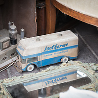 A vintage toy truck and back of an old radio at the flea market in Nice.