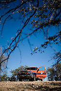 A pickup truck used by Enrique Enriquez Palafox, coordinator of the Nogales office of Grupo Beta, sits on a hill in the desert near Nogales, Sonora, Mexico, on Friday, Feb. 1, 2008. Grupo Beta is an agency of the Mexican federal government that provides services to migrants. The work can be dangerous; Palafox has been shot five times.