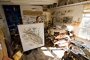 Tijuana Mexico ..artist Estella Hussong at her studio in Ensenada..While working on this long term project 'La Frontera' I want to examine the cultural and humanitarian activities on both sides of a border that keeps the United States and Mexico apart with a wall of steel already 600 miles long. The turf wars of drug cartels, arms trafficking and rampant kidnappings turned cities like Tijuana into some of the most dangerous places on earth. Despite the violence many brave artists, photographers, architects, poets, humanitarians, teachers etc live and work in the shadow of the wall on both sides and have a positive influence on this region; they are the focus of my long term project along the border. (Over time I plan to cover the entire length from the Atlantic to the Pacific, these images were taken in and around Tijuana).© Stefan Falke