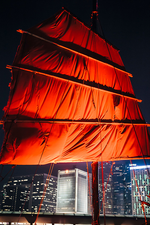 Aqualuna, a traditional Chinese junk sailing Hong Kong Harbour