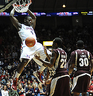 "Mississippi's Demarco Cox (4) dunks vs. Mississippi State at the C.M. ""Tad"" Smith Coliseum in Oxford, Miss. on Wednesday, January 18, 2012. Mississippi won 75-68. (AP Photo/Oxford Eagle, Bruce Newman)."