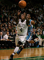 Boston, MA - Boston Celtics guard Nate Robinson, pulls in a pass, as New Orleans Hornets guard Chris Paul gives chase in the first quarter at TD Garden on New Years Eve, December 31, 2010.   Photo by Matthew Healey