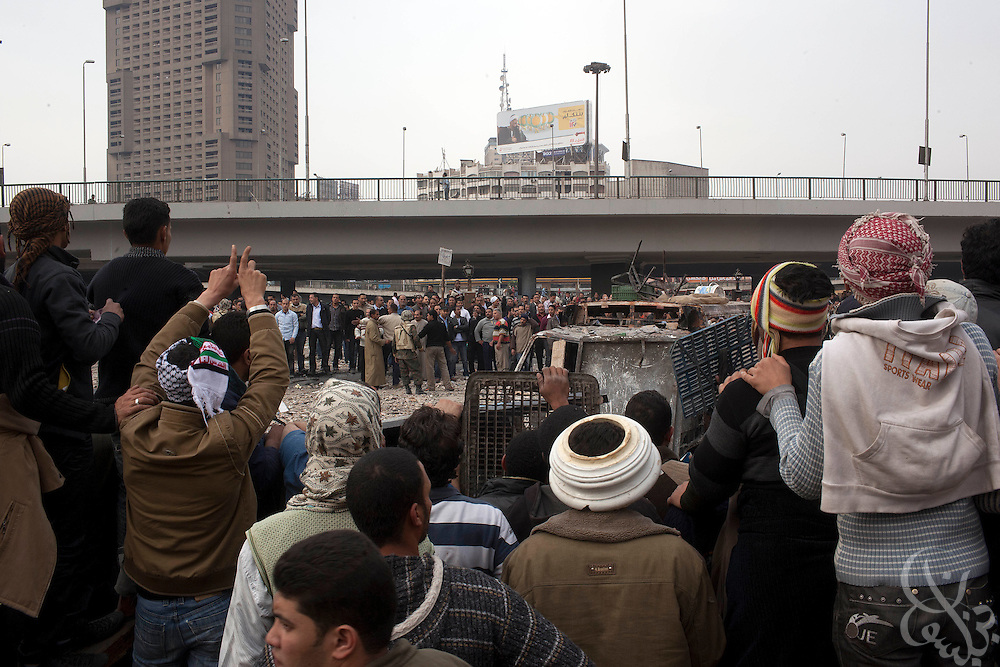 Anti-Hosni Mubarak protesters face off behind makeshift barricades with Mubarak supporters near Tahrir square area February 03, 2011  in Cairo, Egypt. Protesters from both sides clashed throughout the day, throwing rocks and fighting at close range. . .Photo by Scott Nelson