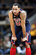 SHOT 1/21/12 6:52:19 PM - Arizona's Brendon Lavender #24 catches his breath while playing against Colorado during their PAC 12 regular season men's basketball game at the Coors Events Center in Boulder, Co. Colorado won the game 64-63..(Photo by Marc Piscotty / © 2012)