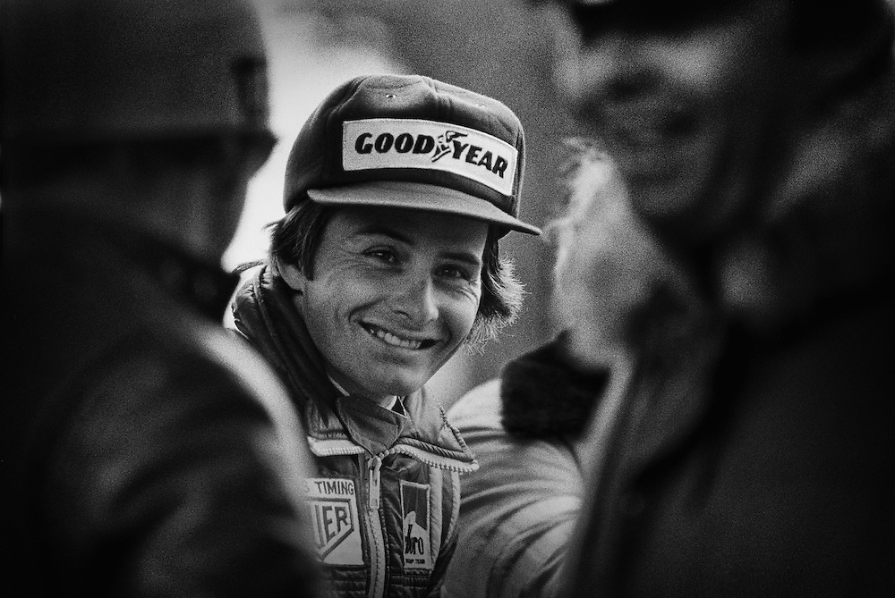 In 1977, Enzo Ferrari personally signed Gilles Villeneuve to a Formula 1 contract. The young Canadian phenom, who reminded Enzo of a young Tazio Nuvolari, was to make his debut for the Scuderia in Niki Lauda's empty seat at that year's Canadian Grand Prix at Mosport.<br /> <br /> After all photojournalists had been removed from the Mosport pit lane prior to the start of that morning's first practice, I found a small split behind the enclosed Ferrari pit stall and waited. My patience was rewarded with this image of a joyful Villeneuve at the moment Ferrari placed the team's jacket on his shoulders.<br /> <br /> The legend had begun.