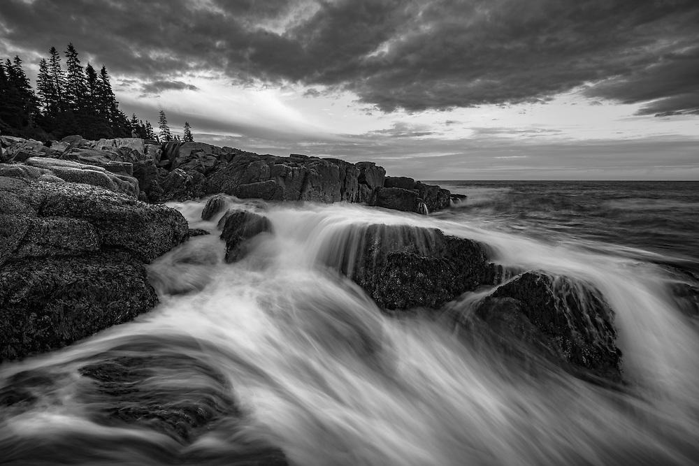 Crashing waves along the rocky coast of Maine, Otter Point, Acadia National Park, Maine, USA (black and white)