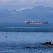 A cargo ship nears Cape Flattery on Neah Bay, Washington.