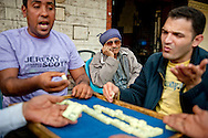 Outside a cafe in Giza near the pyramids men play dominoes to pass the time on February 7, 2011. The area took an economic hit during the high tourist season. Ann Hermes/© The Christian Science Monitor 2011