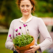 LONDON, UK - 21 May 2012: actress Geraldine Somerville launches new plant Osteospermum 'In the Pink' at 'Hardy's Cottage Garden Plants' stand at the RHS Chelsea Flower Show 2012.