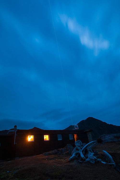 A green laser beam is projected into the sky to measure the chemical composition of the upper atmosphere at the Polish Polar Station in Hornsund, Svalbard.