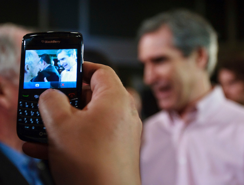Liberal leader Michael Ignatieff is photographed by a supporter during a campaign stop in London, Ontario, March 31, 2011. <br /> AFP/GEOFF ROBINS/STR